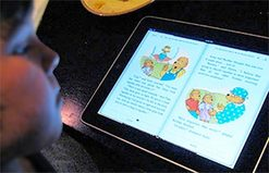 Photo of Child Reading eBook On Tablet